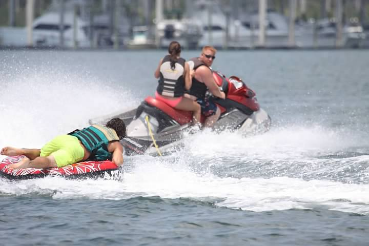 image of beaumont residents on tube and jetski